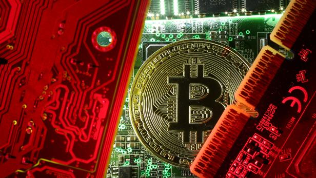 FILE PHOTO: FILE PHOTO: A copy of bitcoin standing on PC motherboard is seen in this illustration picture