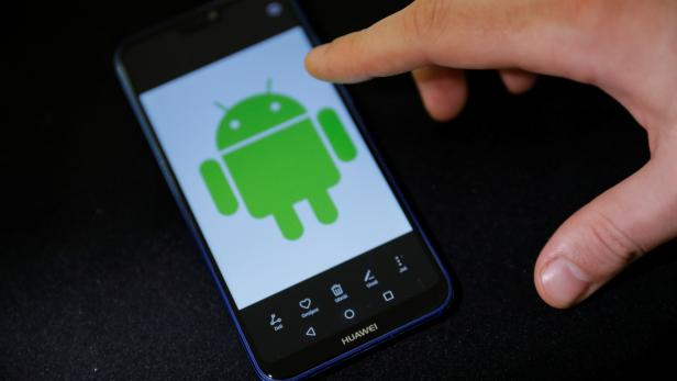 Android logo is displayed on a Huawei smartphone in this illustration picture