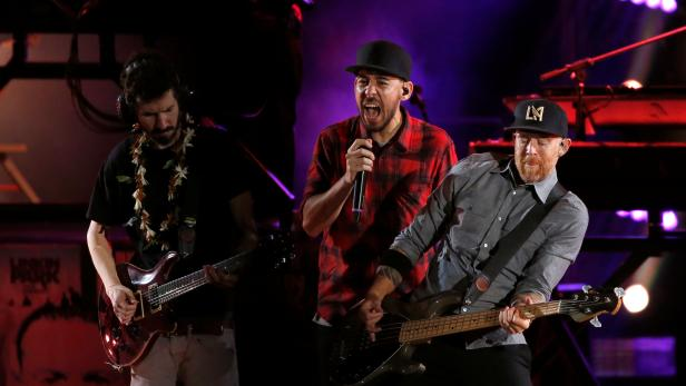 """Shinoda, Delson and Farrell of Linkin Park perform during the """"Linkin Park & Friends Celebrate Life in Honor of Chester Bennington"""" concert at Hollywood Bowl in Los Angeles"""