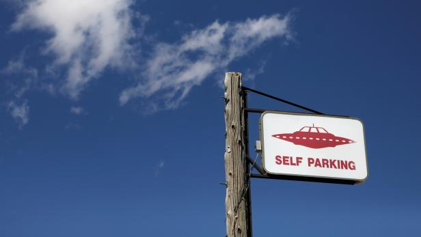 A parking sign at the Little A'Le'Inn as an influx of tourists responding to a call to 'storm' Area 51, a secretive U.S. military base believed by UFO enthusiasts to hold government secrets about extra-terrestrials, is expected in Rachel, Nevada