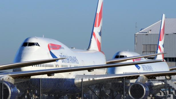 FILE PHOTO: British Airways aircraft are parked at Heathrow airport in west London