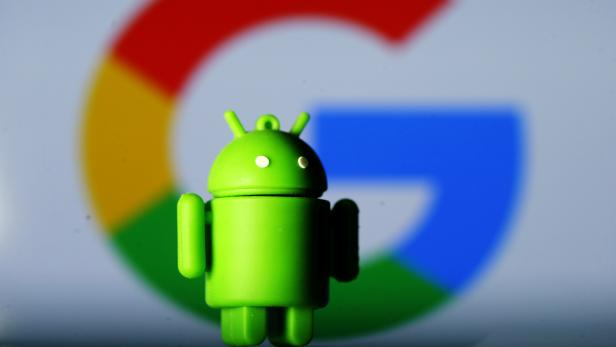 FILE PHOTO: A 3D printed Android mascot Bugdroid is seen in front of a Google logo in this illustration
