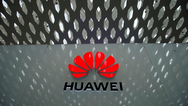 FILE PHOTO: A Huawei company logo is seen at the Shenzhen International Airport in Shenzhen