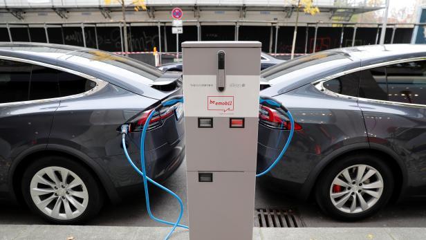 Tesla Model X electric cars recharge their batteries in Berlin