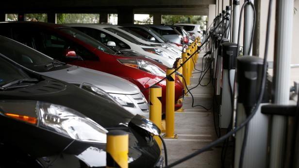 FILE PHOTO: Electric cars sit charging in a parking garage at the University of California, Irvine