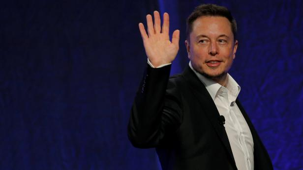 Tesla Motors CEO Elon Musk waves as he leaves the stage after speaking at the National Governors Association Summer Meeting in Providence