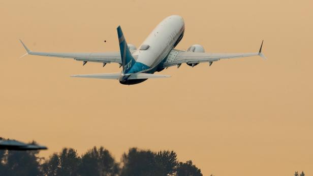 FAA Chief Steve Dickson takes off in a Boeing 737 MAX aircraft in Seattle