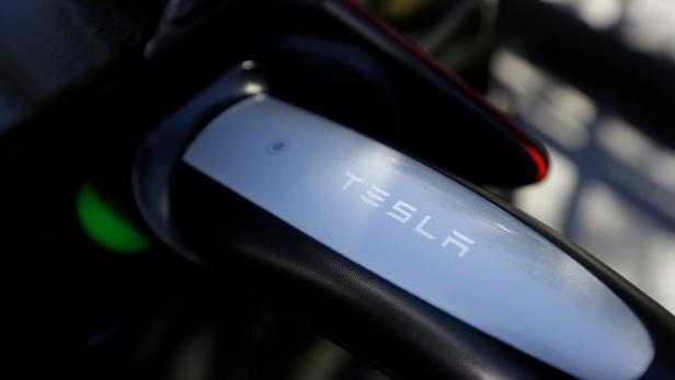 A Tesla Model S electric car is charged by a supercharger at a Tesla electric car dealership in Sydney