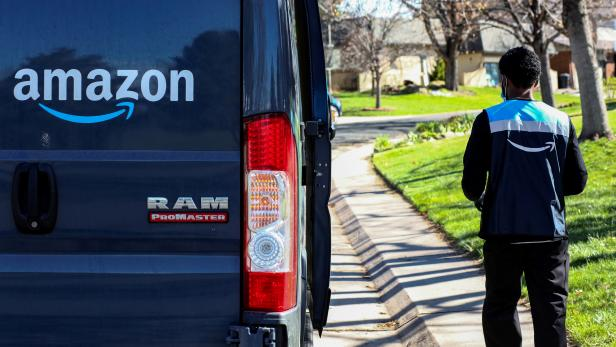 FILE PHOTO: An Amazon worker delivers packages