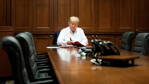 U.S. President Donald Trump works in a conference room while receiving treatment after testing positive for the coronavirus disease (COVID-19) at Walter Reed National Military Medical Center in Bethesda, Maryland