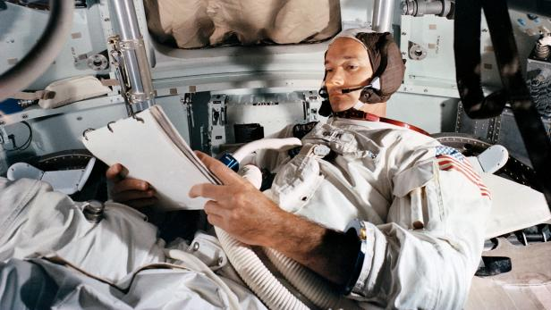 FILE PHOTO: Command Module pilot Michael Collins practices in the CM simulator at Kennedy Space Center