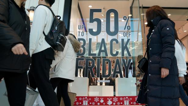 FILE PHOTO: People shop in King of Prussia Pennsylvania on Black Friday
