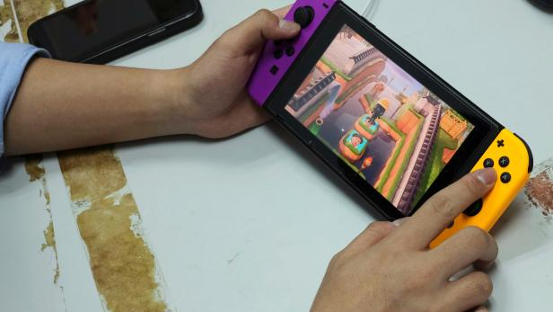 """Pro-democracy activists Joshua Wong demonstrates playing the game """"Animal Crossing"""" on Nintendo Switch in Hong Kong"""