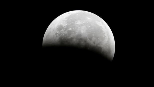 """FILE PHOTO: A total lunar eclipse, also known as a """"blood moon"""", is pictured from Santa Monica"""