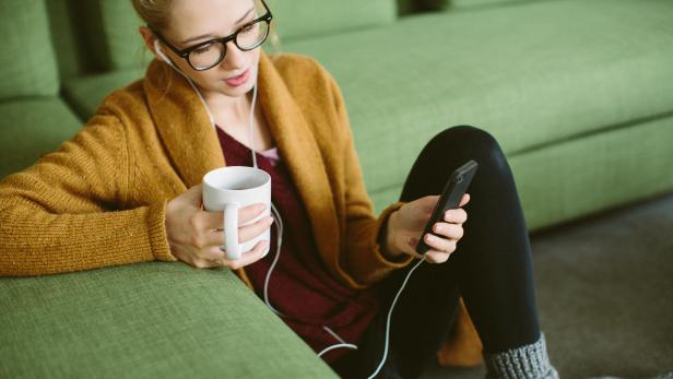 Relaxed young girl listening music