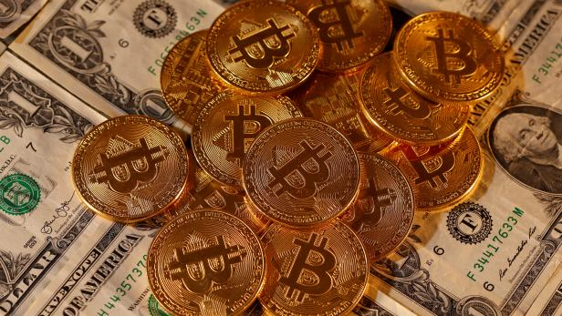 FILE PHOTO: Representations of virtual currency Bitcoin and U.S. dollar banknotes are seen in this picture illustration