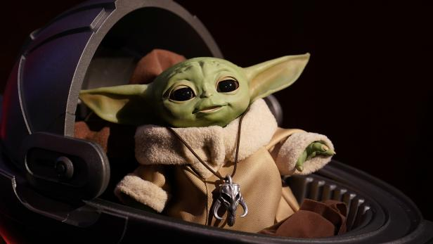 """An animatronic Baby Yoda toy is pictured  during a """"Star Wars"""" advance product showcase in the Manhattan borough of New York City"""