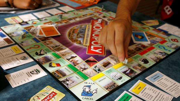 File Photo: A Monopoly player in Madrid participates in an attempt to set a  world record for most people playing the game simultaneously