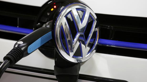 FILE PHOTO: A Volkswagen vehicle is charged during a workshop in Guangzhou