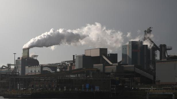 FILE PHOTO: Smoke is seen coming out of a chimney at the Tata steel plant in Ijmuiden