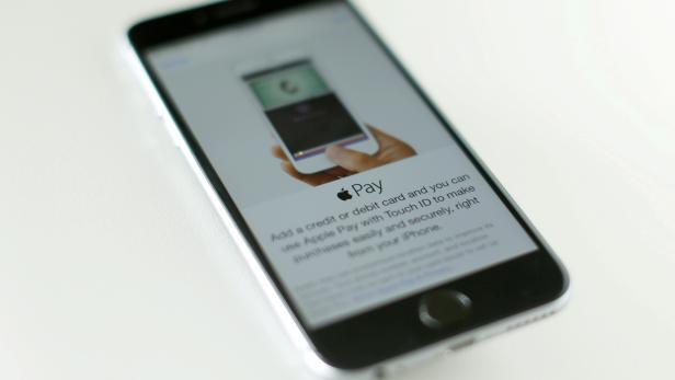 FILE PHOTO: An Apple iPhone 6 with Apple Pay is shown in this photo illustration in Encinitas, California