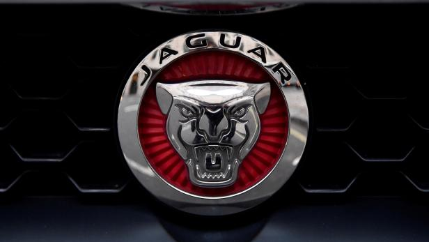 FILE PHOTO: A Jaguar logo is seen on a car in central London, Britain