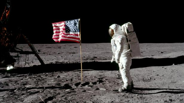 FILE PHOTO: Buzz Aldrin poses for a photograph beside the United States flag on the moon