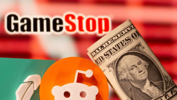 FILE PHOTO: A 3d printed Robinhood and Reddit logos are seen near one dollar banknotes in front of displayed GameStop logo