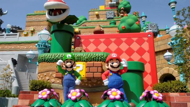 Mario and Luigi characters greet visitors inside Super Nintendo World at the Universal Studios Japan theme park in Osaka, Japan