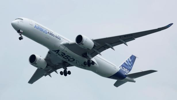 FILE PHOTO: An Airbus A350-900 aircraft performs a flight pass during the Singapore Airshow in Singapore