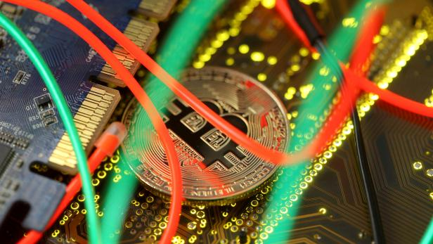 FILE PHOTO: Representation of the Bitcoin virtual currency standing on the PC motherboard is seen in this illustration picture