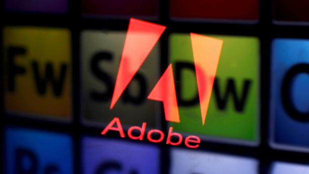 FILE PHOTO: Picture illustration shows Adobe logo and Adobe products reflected on a monitor display and an iPad screen, in central Bosnian town of Zenica