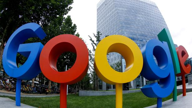 FILE PHOTO: The brand logo of Alphabet Inc's Google is seen outside its office in Beijing