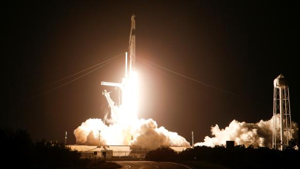 A SpaceX Falcon 9 rocket, with the Crew Dragon capsule, is launched carrying four astronauts on a NASA commercial crew mission to the International Space Station