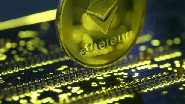 FILE PHOTO: Representation of the Ethereum virtual currency standing on the PC motherboard is seen in this illustration picture