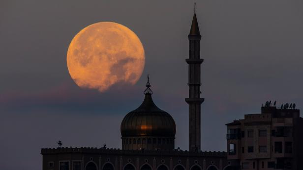 """A super moon, known as the """"Super Flower Moon"""", rises over the Nabi Sain Mosque in Nazareth"""