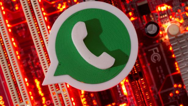 FILE PHOTO: FILE PHOTO: A 3D printed Whatsapp logo is placed on a computer motherboard