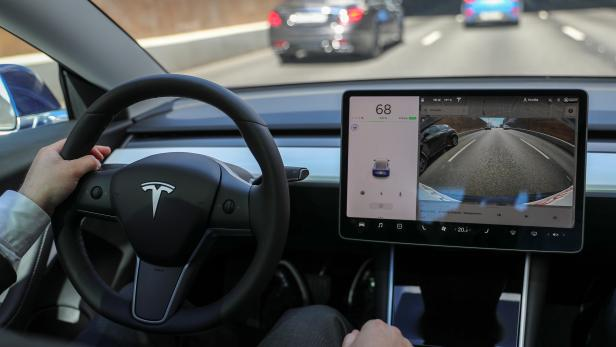 The interior of a Tesla Model 3 electric vehicle is shown in Moscow