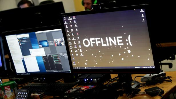 """A computer desktop with wallpaper that reads """"Offline"""" is pictured during the Electronic Sports Festival, Austria's largest LAN Party in Vienna"""