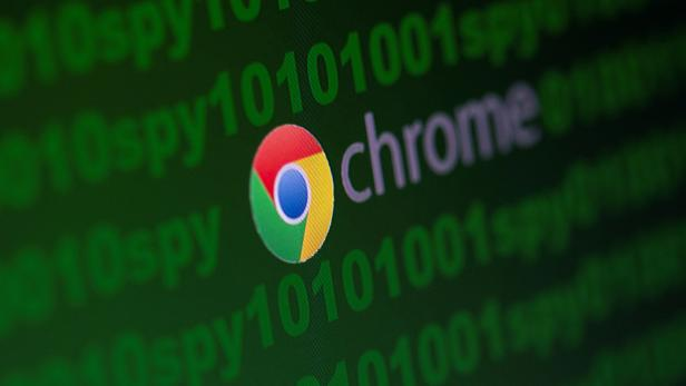 """FILE PHOTO: Google Chrome logo is seen near cyber code and words """"spy""""  in this illustration picture"""