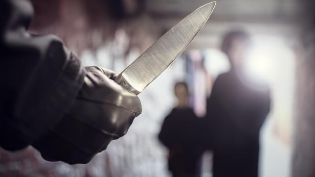 Criminal with knife weapon threatening woman in underpass crime