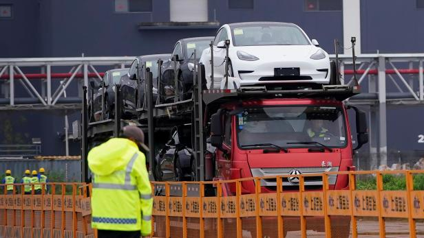 A truck transports new Tesla cars at its factory in Shanghai