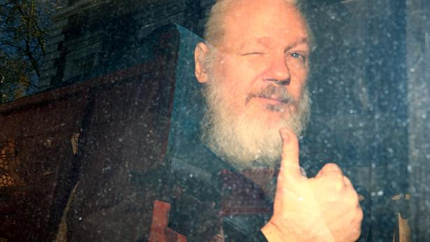 FILE PHOTO: WikiLeaks founder Julian Assange arrives at the Westminster Magistrates Court in London