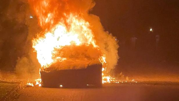 Handout photo of Tesla Inc's new Model S Plaid electric car seen in flames in Pennsylvania