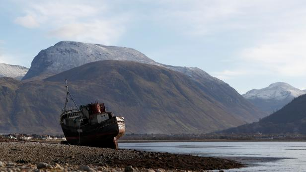 The wreck of the Golden Harvest, a fishing vessel that ran aground on the banks of Loch Linnhe in 2011, is seen in front of the UK's highest mountain Ben Nevis near Fort William