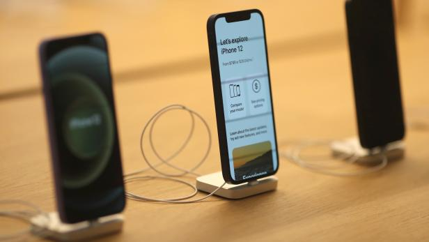 IPhone 12 phones are seen at the new Apple Store on Broadway in downtown Los Angeles