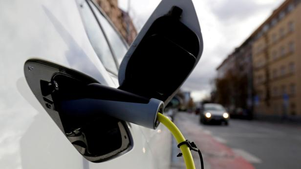 FILE PHOTO: An electric car is charged by a mobile charging station on a street in Prague