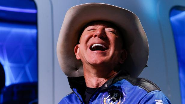 Billionaire American businessman Jeff Bezos reacts at a post-launch press conference, in the nearby town of Van Horn