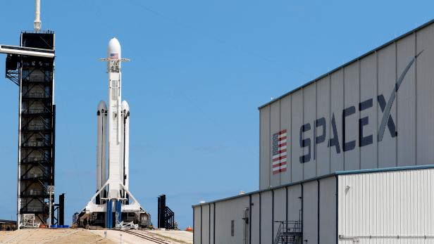FILE PHOTO: A SpaceX Falcon Heavy rocket with the Arabsat 6A communications satellite aboard is prepared for launch later in the day at the Kennedy Space Center in Cape Canaveral