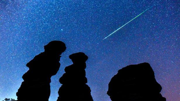 Perseid meteor shower over the stone dools in Kuklice